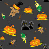 Vector seamless background Halloween kit scarecrow, pumpkins, candles, graves and cross Royalty Free Stock Image