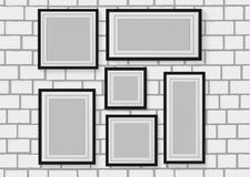 Vector seamless background image of wood photo frames on the white brick wall Stock Photography
