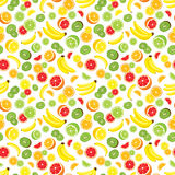 Vector seamless background of lemon, orange, lime, grapefruit, kiwi slices and bananas. Multivitamin fruits. Royalty Free Stock Images
