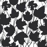 Vector seamless background with maple leaves  for fashion textile or web background. Black silhouette on white background. Vector Stock Image