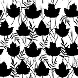 Vector seamless background with maple leaves  for fashion textile or web background. Black silhouette on white background. Vector Stock Images