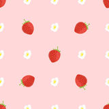 Vector seamless background of strawberry surrounded with flowers. Vector seamless background/pattern of strawberry surrounded with flowers on pionk background Stock Images