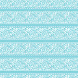 Vector seamless background. White lace on light blue Stock Images