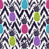 Vector seamless ethnic pattern with pineapples. Vector seamless black and white ikat ethnic pattern with colorful pineapples royalty free illustration
