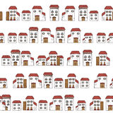 Vector seamless cartoon pattern, made of collection houses in old European style.  white facades and red roofs. Stock Photography
