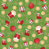 Vector seamless Christmas pattern background with Santa Claus, gift sack, gingerbread cookies, red sock, gift box and candy stick. Vector seamless Christmas Stock Images