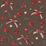 Vector seamless Christmas pattern with bows, stars and berries. royalty free stock images