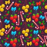 Vector seamless christmas pattern with decoration balls, holly berry, bow, lollipop  on dark background Stock Images