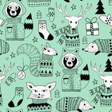 Vector Seamless Christmas Pattern with Doodle Animals in the Woo. D Stock Image
