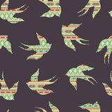 Vector seamless colorful decorative ethnic pattern with swallows Royalty Free Stock Photography