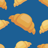 Vector seamless croissant pattern on blue background. Design for cards, menu, textile, fabric.  Royalty Free Stock Image