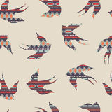 Vector seamless decorative ethnic pattern with swallows Stock Photography