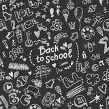 Vector seamless doodled pattern with many school supplies Royalty Free Stock Photo