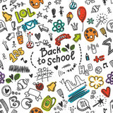 Vector seamless doodled pattern with many school supplies Stock Photography