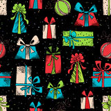 Vector seamless festive pattern. Hand drawn gifts on black background Royalty Free Stock Photography