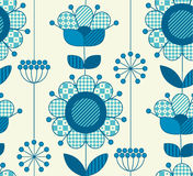 Vector seamless flower pattern for surface design. In traditional folk style. Geometry 60s inspired floral  illustration in blue pottery color for wrapping Stock Images