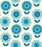 Vector seamless flower pattern for surface design. In traditional folk style. Geometry 60s inspired floral  illustration in blue pottery color for wrapping Stock Photography