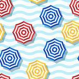 Vector seamless geometric pattern. Flat 3d style beach umbrella and wavy striped background. Trendy design concept for summer fashion textile print Royalty Free Stock Photography
