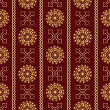Vector seamless gold vintage ornamental pattern on dark red background Stock Images