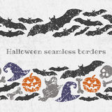 Vector seamless halloween pattern borders with scary symbols Stock Images