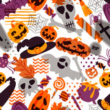 Vector seamless Halloween pattern. Doodle pumpkin, skull, witch hat, bones on white background. Royalty Free Stock Images