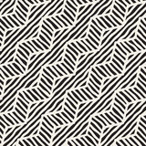 Vector seamless hand drawn pattern. Zigzag and stripe rough lines. Tribal design background. Ethnic doodle texture. Royalty Free Stock Photo