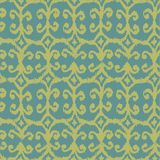 Vector seamless ikat pattern with yellow and blue. For textile, fabric, craft, wrapping Royalty Free Stock Photo