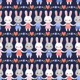 Vector seamless illustration with cute hares. Stock Image