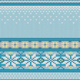 Vector seamless knitted pattern with snowflakes Royalty Free Stock Photo