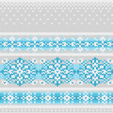 Vector seamless knitted pattern with snowflakes Stock Images