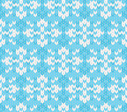 Vector seamless knitted pattern with snowflakes Royalty Free Stock Photos