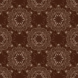 Vector Seamless Mandala Pattern over dark brown Royalty Free Stock Image
