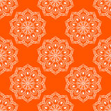 Vector Seamless Mandala Pattern over orange Royalty Free Stock Images