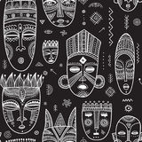 Vector seamless pattern with African ethnic tribal masks decorat Stock Photos
