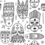 Vector seamless pattern with African ethnic tribal masks Royalty Free Stock Photo