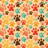 Vector seamless pattern with animal paws. Cartoon background Stock Photography