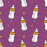 Vector seamless pattern with baby feeding bottle with dummy Royalty Free Stock Image