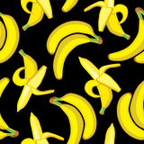 Vector seamless pattern background with bright bananas Stock Photos