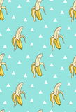 Vector seamless pattern with bananas and triangles. Stock Photo