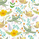 Vector seamless pattern of birds and flowers in cartoonish style. Stock Images