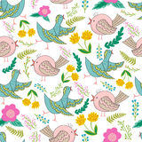 Vector seamless pattern of birds and flowers in cartoonish style. Stock Image