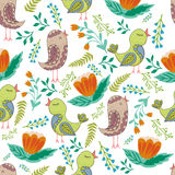 Vector seamless pattern of birds and flowers in cartoonish style. Vector seamless pattern of birds and flowers in cartoonish style Stock Photo