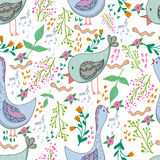Vector seamless pattern of birds and flowers in cartoonish style. Vector seamless pattern of birds and flowers in cartoonish style Royalty Free Stock Images