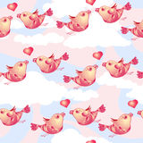 Vector seamless pattern with birds and hearts on cloudy background. Stock Image