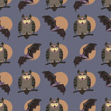 Vector seamless pattern with birds. Owls on the branches and bats. Halloween theme. Stock Photography