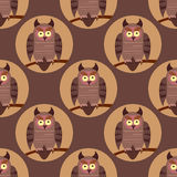 Vector seamless pattern with birds. Owls on the branches. Royalty Free Stock Image