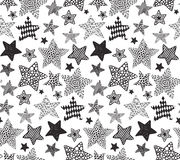 Vector seamless pattern with black hand drawn stars. On white background. Holiday Christmas or Birthday endless background in graphic doodle style for prints Royalty Free Stock Photography