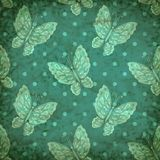 Vector seamless pattern with blue butterfly Stock Photography