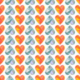 Vector seamless pattern with blue and orange hearts. Polygonal design. Geometric triangular origami style, graphic illustration. Royalty Free Stock Image