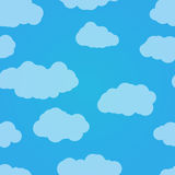 Vector seamless pattern. Blue sky with clouds. Light background. Royalty Free Stock Image